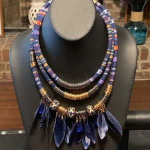 Triple strand knit, disks and feathers necklace